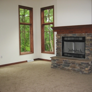 custom home den with fireplace